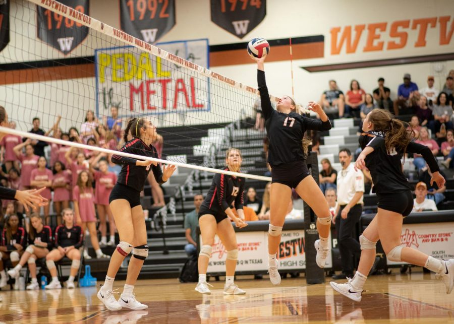 Kenzie+Beckham+%2721+sets+the+ball+for+McKayla+Ross+%2722.+Ross+was+able+to+strike+the+ball+which+led+the+a+point+for+the+Warriors.+%22I+am+really+proud+of+our+fight%2C+we+kept+on+going%2C+no+matter+what+the+score+was+we+kept+on+pushing%2C%22+Beckham+said.