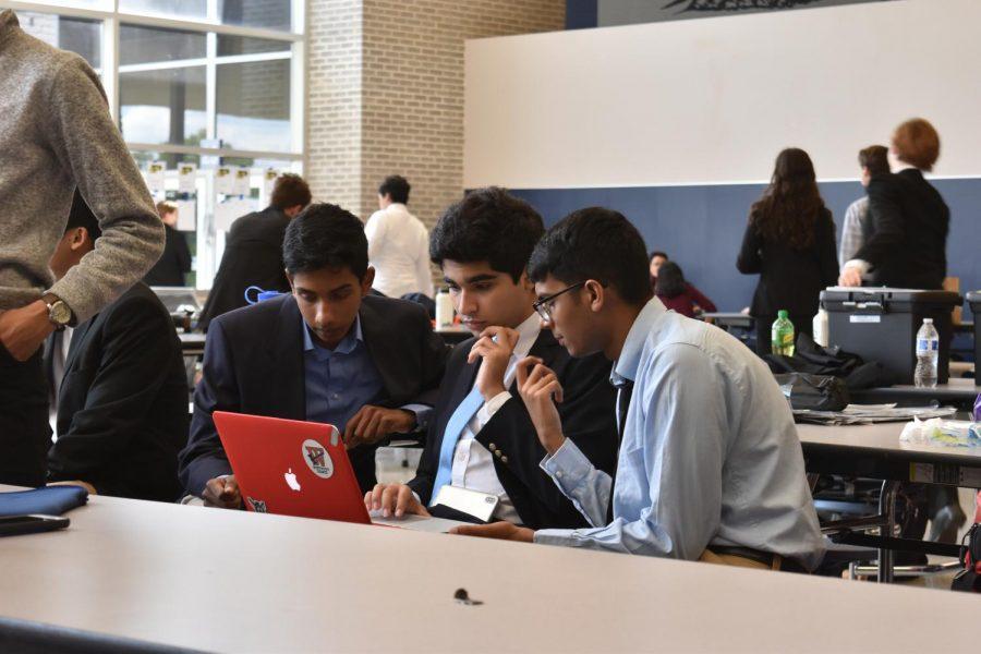 To prepare new arguments,  Harsha Rajesh '20, Daniel Tehrani '20, and Samit Deshmukh '20 read an article. Photo courtesy of WHS Speech and Debate.