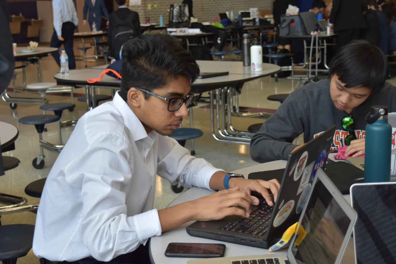 Getting+ready+for+his+quarter-finals+round%2C+Pranav+Medikonduru+%2722+types+on+his+laptop.+Photo+courtesy+of+WHS+Speech+and+Debate.