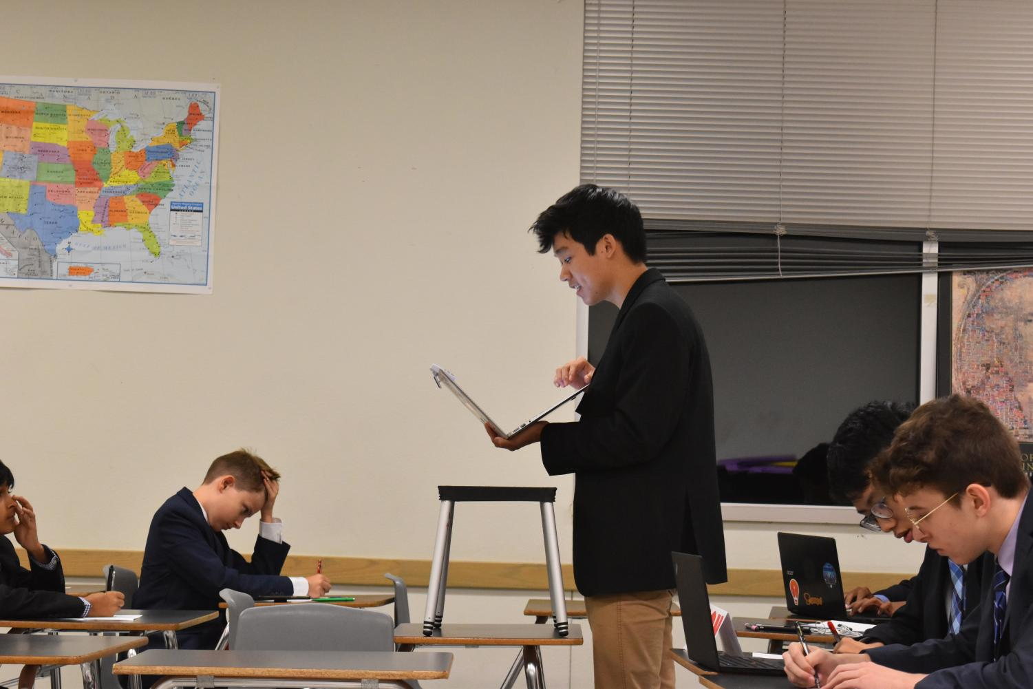 Starting+off+his+semi-finals+round%2C+Frank+Lai+%2720+reads+out+his+case.+Photo+courtesy+of+WHS+Speech+and+Debate.