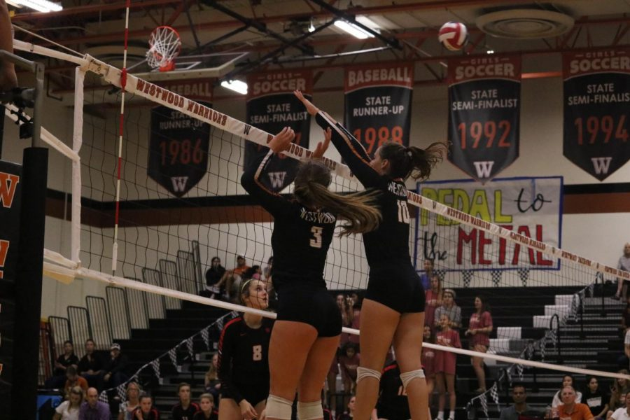 Audrey Quesnel 20 and Abby Gregorczyk 21 leap into the air to try and stop the ball from coming over the net. The team has a great system set in place to help the middles with doing their job. We have a pretty good scouting report we talked about before the game so we usually have an idea on what they are going to run, Quesnel said.