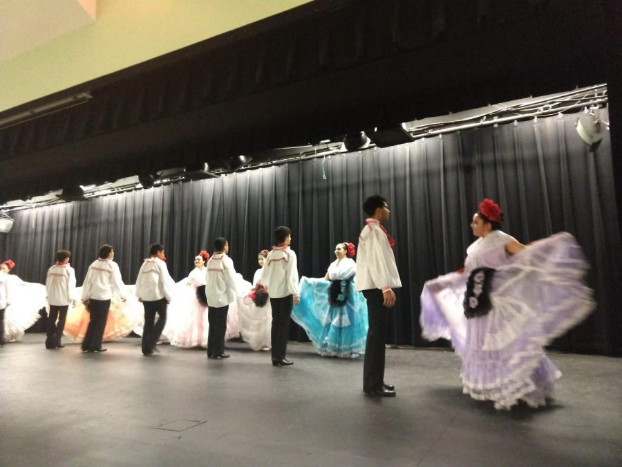 During first lunch, Hispanic dancers perform in the cafeteria.