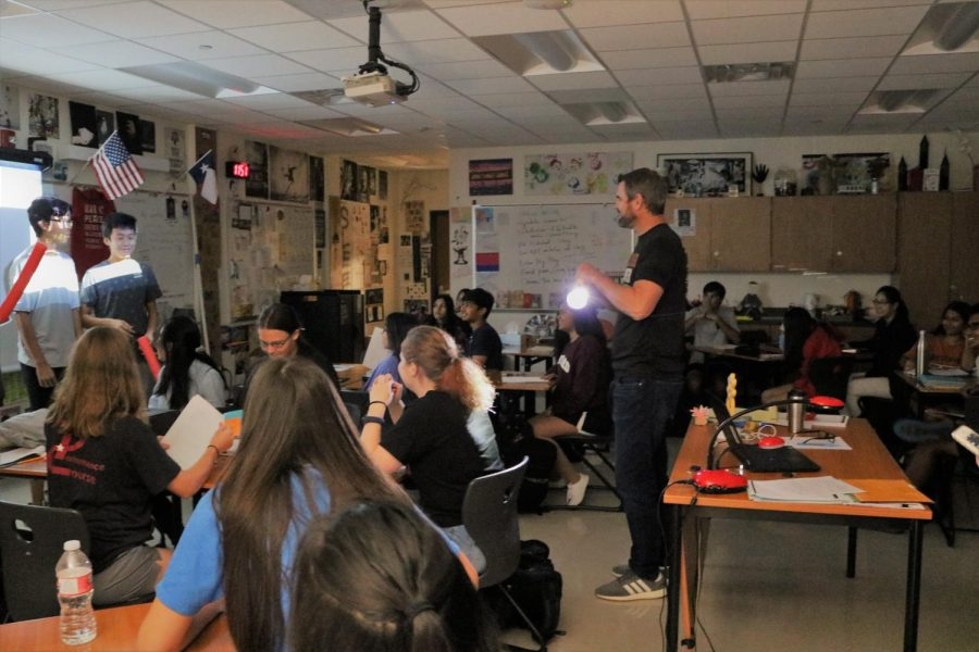 Mr. Chalk and his class participate in a review game before their test. In the game, students had to hit their foreheads with pool noodles in order to answer a question.