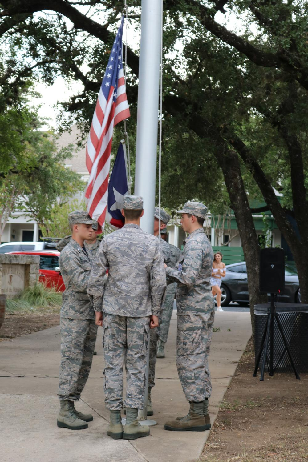 Owen+Darden+%2720+lowers+the+flags+with+the+help+of+three+other+cadets.+JROTC+takes+the+flags+down+every+day+after+school%2C+though+most+days+only+three+cadets+in+total+do+the+job.+
