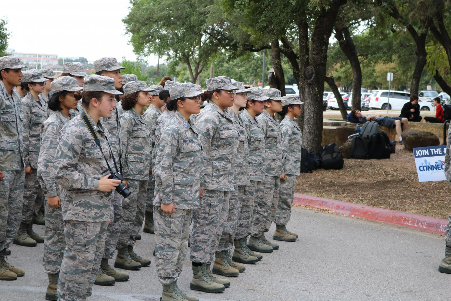 Cadets+stand+at+attention+while+the+flags+are+taken+inside.+The+upperclassmen+are+dressed+in+their+class+D+uniforms+while+freshman+are+dressed+in+class+H+uniforms.+