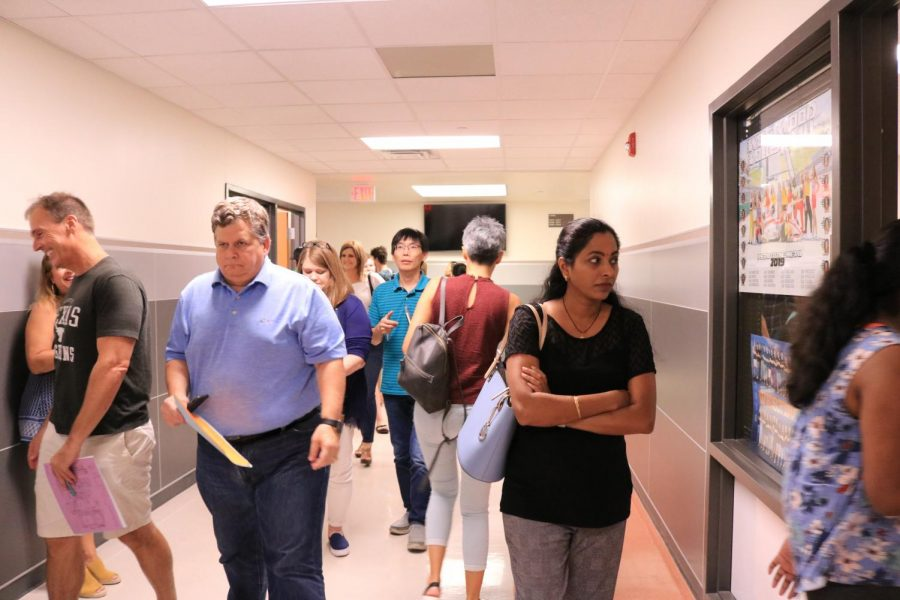 Parents experience the confusion their children felt on their first day of school. Parents use their child's schedule and a map so they can locate their classes.