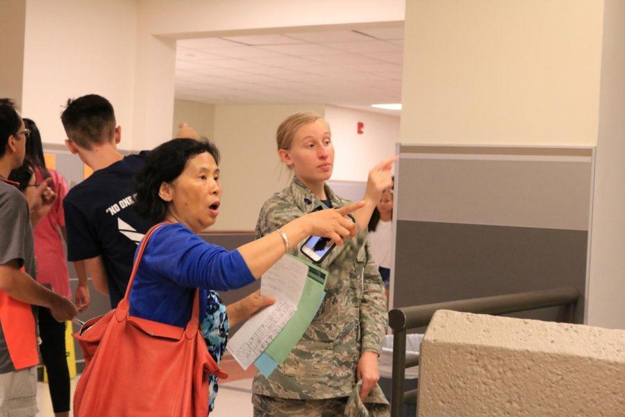 Elena Van Metre '21 tells a parent where to go to get to her next class. Van Metre is the flight commander for incoming JROTC freshman.