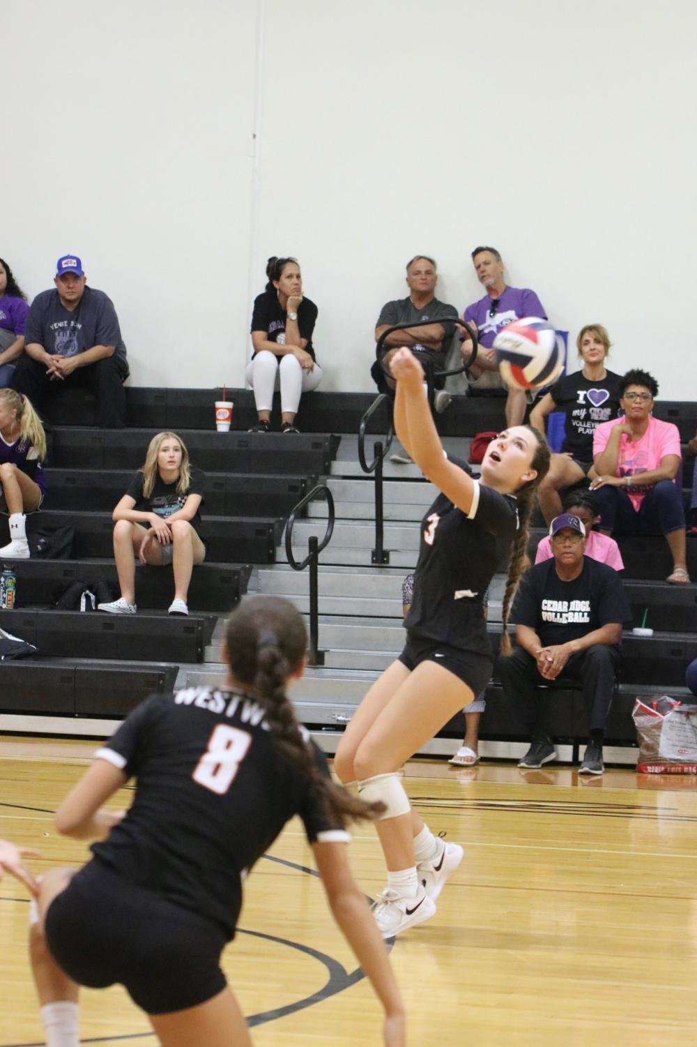 Abbey+Jennings+%E2%80%9822+bumps+the+backwards+to+Cedar+Ridge%2C+scoring+a+point.+This+is+Jennings%E2%80%99+second+year+playing+volleyball+as+a+Lady+Warrior.