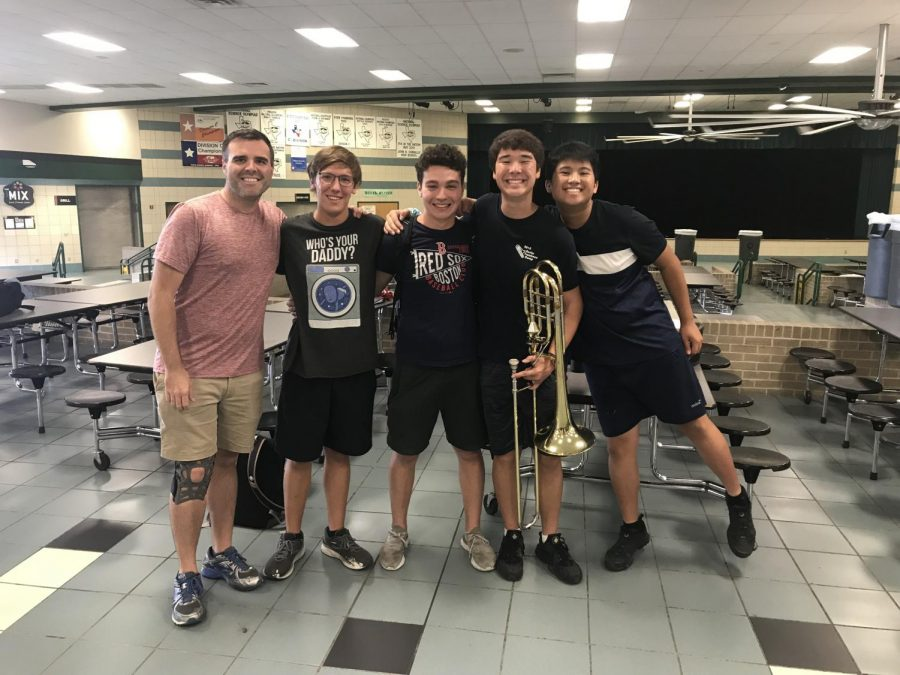 Head Band Director Mr Thomas Turpin, poses with Lyle Moss '20, John Kangos '21, Jason Sato '21, and Kyle Le '22 after the audition. Mr. Turpin judged the trombone audition room where Sato, Moss, and Kangos auditioned in.