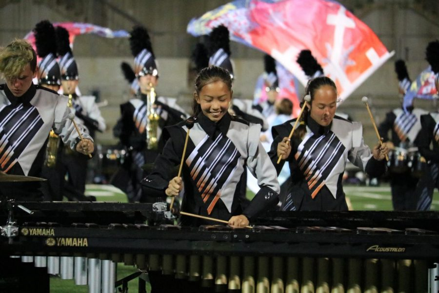 Caroline Zhuang '23 plays the marimba. Zhuang finds football games and performances such as the March-A-Thon fun and exciting as band gets to perform their show.