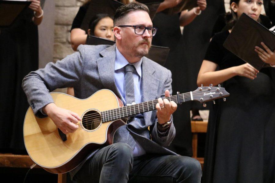 Guitarist Phillip Brummett plays with the Chamber choir. Brummett is a friend of Head Choir Director Mr. Andre Clark.