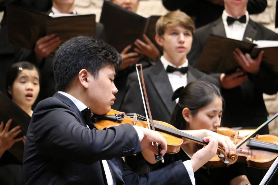 Elliot Kim '21 is playing the violin with the Chamber choir. One of the songs Chamber choir performed, 'The Lake Isle', had a string quartet perform with the singers.