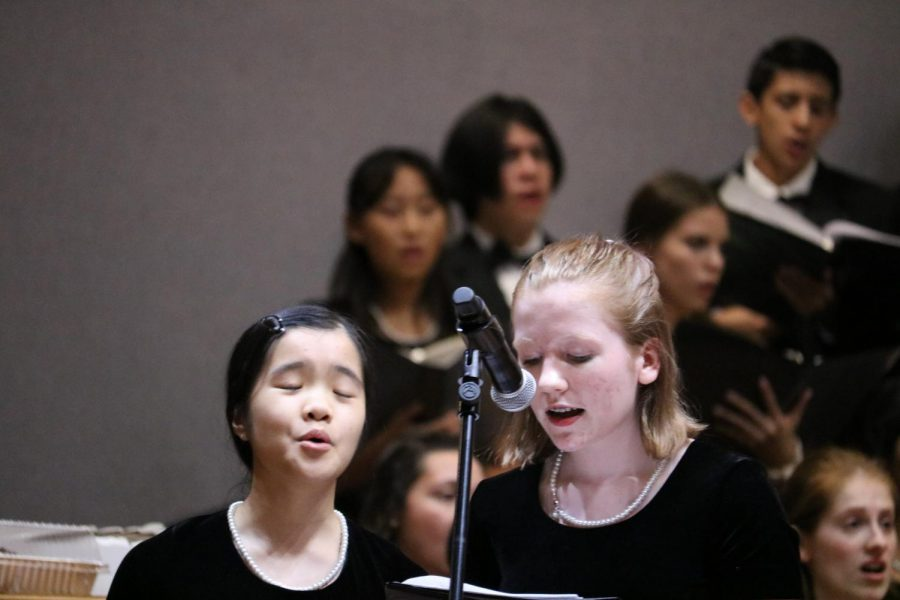 Juniors Helen Huang and Violet Burns are singing their solo in 'Baba Yetu'. Huang and Burns are in Chamber.