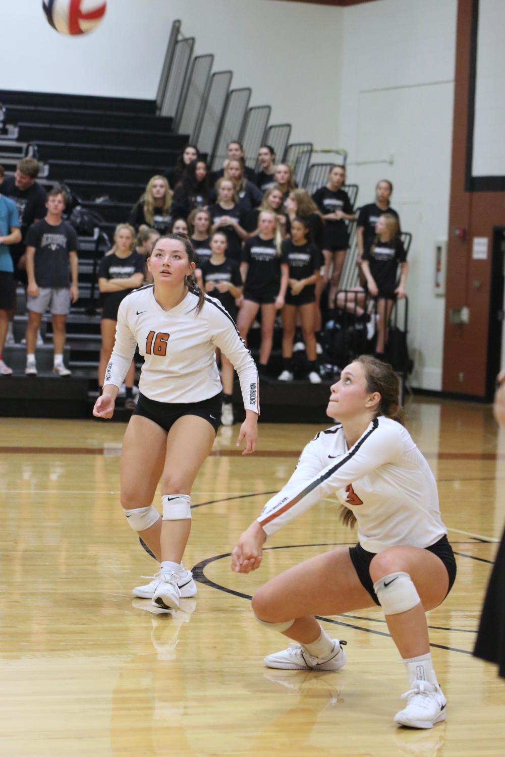 Abby+Gregorczyk+%2721+gets+in+position+to+hit+the+ball%2C+while+Abi+Rucker+%2720+watches+from+behind.+Gregorczyk%27s+bump+scored+a+point.+