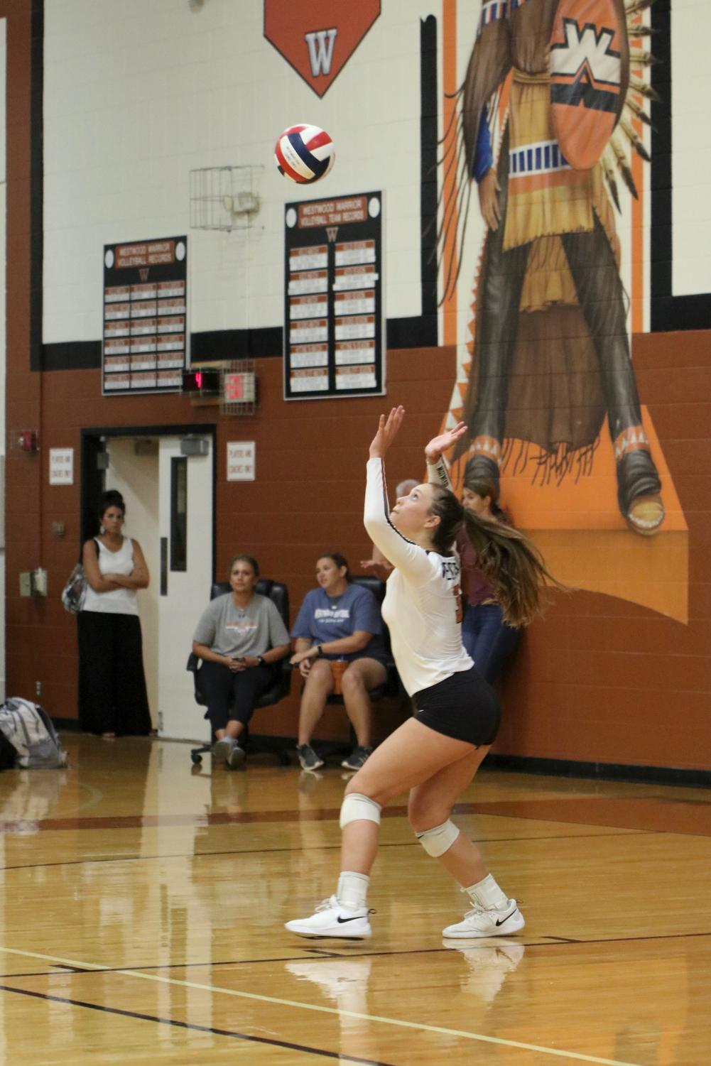 Abby+Gregorczyk+%2721+prepares+to+serve+the+ball+to+Vandegrift.+Gregorczyk+is+an+outside+hitter+for+the+Lady+Warriors.