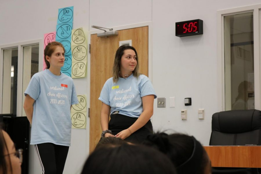 Co-presidents Rachel Rusch '20, and Sarah Sherwood '20 listen as the choir directors give directions. Both are four year choir members, and this is their final camp.