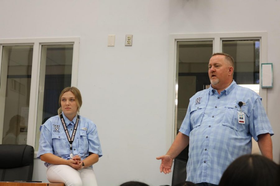 Choir director Mr. Andre Clark and assistant director Ms. Robin Harwell talk to the choir about what they are going to do next. While the choir had fun playing games at camp, they also learned some music to perform at concerts.