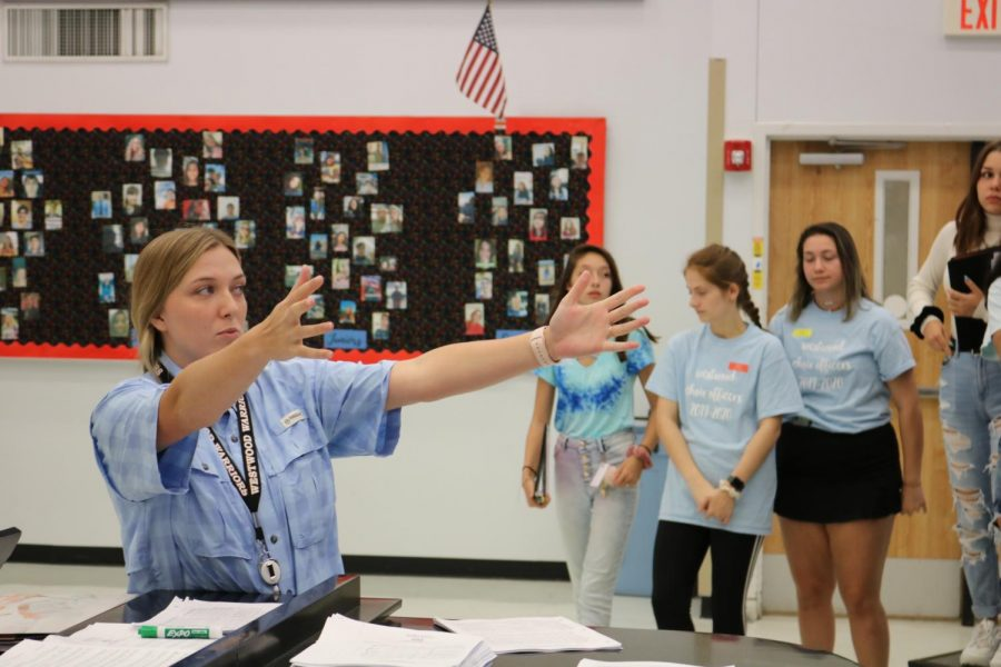 Ms. Robin Harwell prepares to conduct the girls' sectional for 'The Lord Bless You and Keep You'. Though this was her first choir camp, she still had an enjoyable experience.