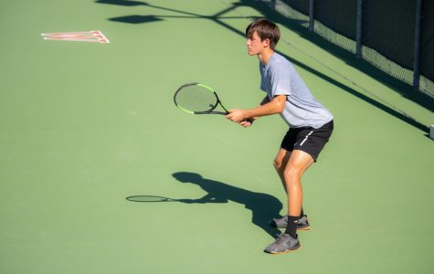 Anticipating a serve from his opponent, Daniel Antov readies himself to return a serve from the backhand side. He would go on to win his match 8-4.