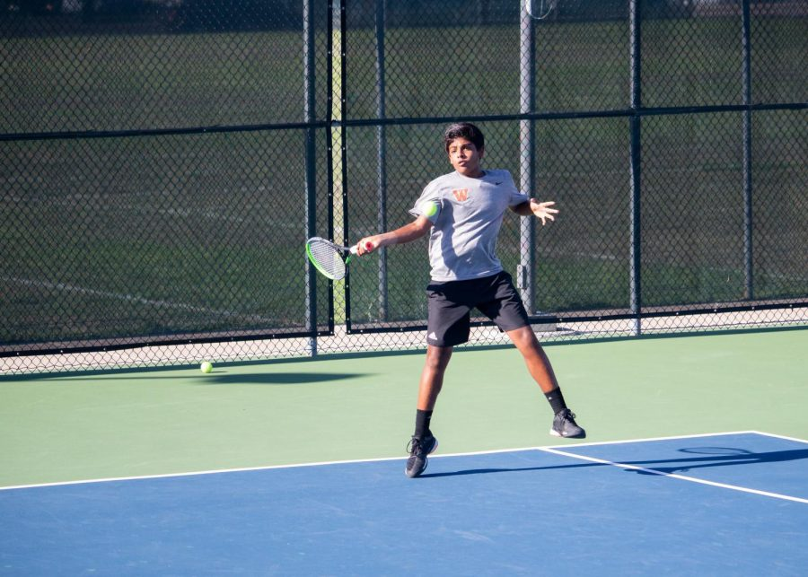 Executing a powerful forehand to his opponent, Rohith Gajjala '22 jumps up to return the ball. He would go on to win his match 4-1.