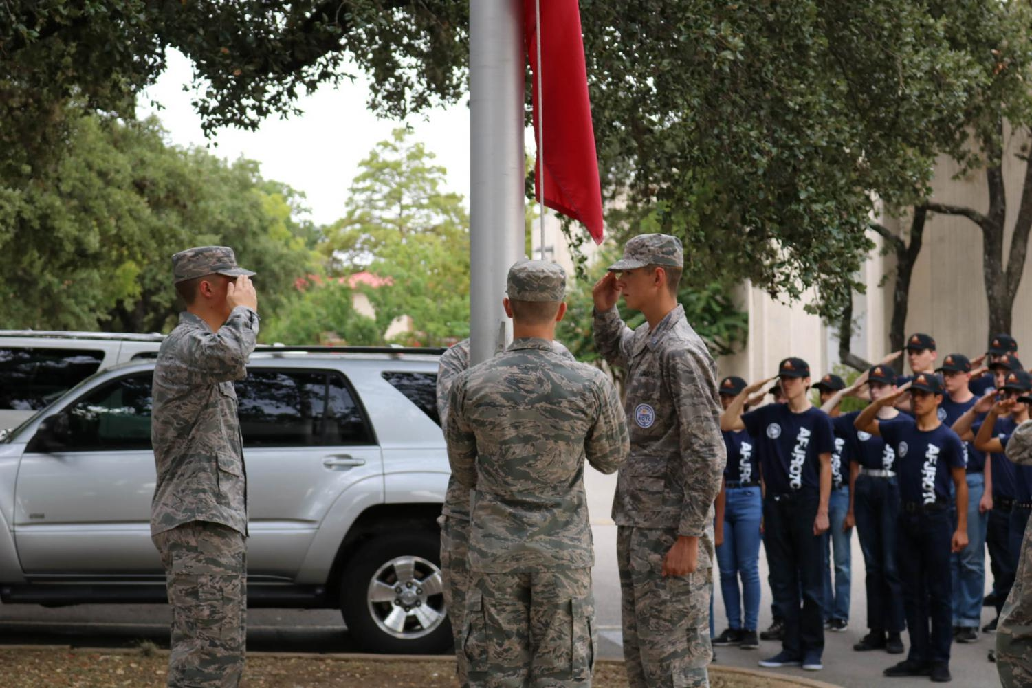 The+upperclassmen+cadets+lower+the+flags+as+the+freshmen+cadets+salute.+This+is+the+first+event+the+freshmen+are+doing+as+a+core.