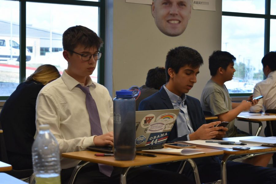 After their quarterfinals debate round, Juniors Jeff Freeman and Arnav Gunwani wait for the judges' decisions. Photo courtesy of WHS Speech and Debate.