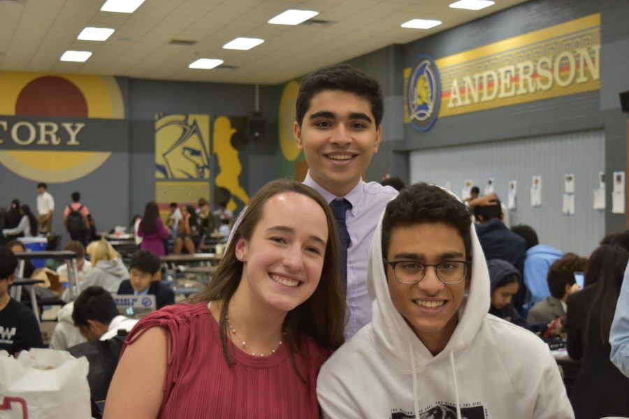 While waiting for debate results, seniors Daniel Tehrani and Pranav Kulkarni take a photo with alumni Elisa Baxter. Photo courtesy of WHS Speech and Debate.