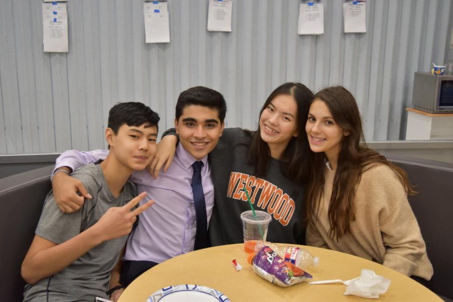 During the tournament, Nathan Fang '22, Daniel Tehrani '20, Sophia Wang '21, and Mika Freund '21 chat. Photo courtesy of WHS Speech and Debate.