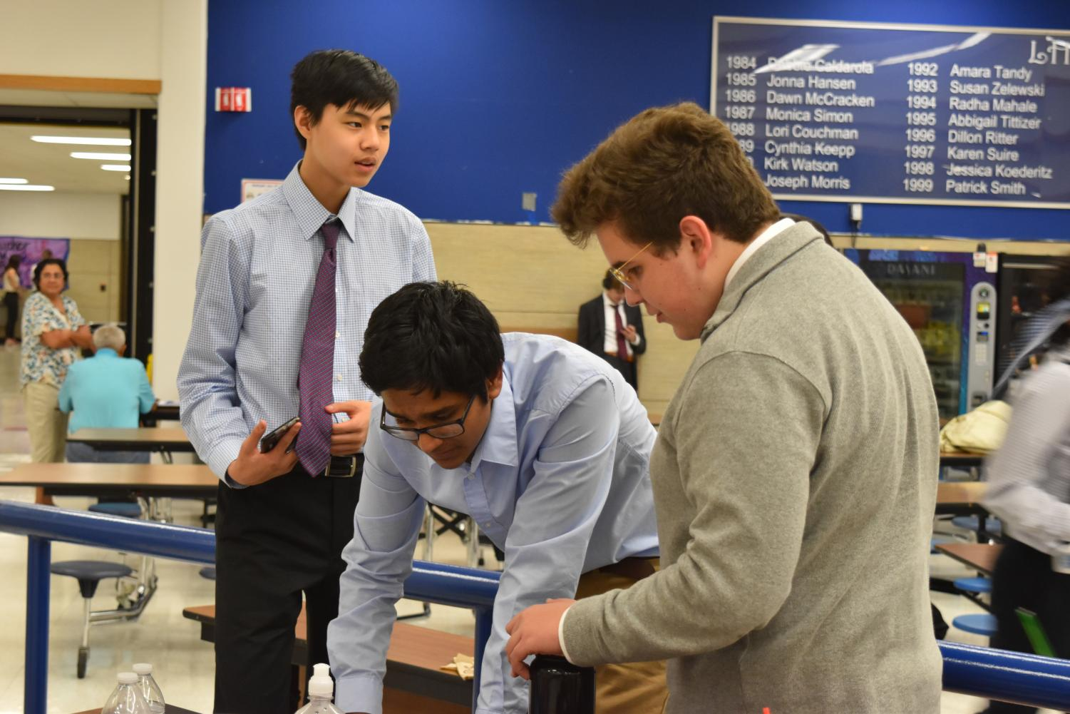 In+between+rounds%2C+Anoop+Rachakonda+%2722+shows+Nathan+Fang+%2722+and+Bryce+Keeler+%2721+an+argument.+Photo+courtesy+of+WHS+Speech+and+Debate.