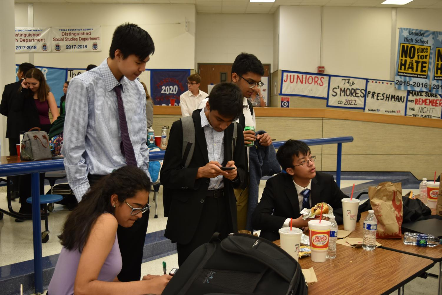 While+waiting+for+their+results%2C+debaters+discuss+the+tournament.+Photo+courtesy+of+WHS+Speech+and+Debate.