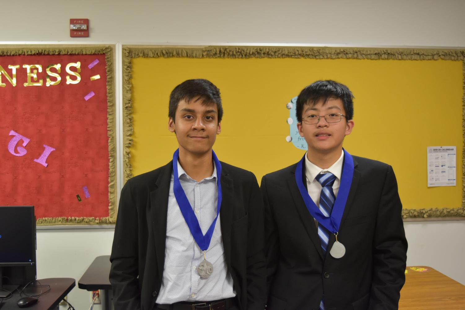 Partners+Akhil+Bhale+%2722+and+Joshua+King+%2722+pose+with+their+semi-finalist+medals.+Photo+courtesy+of+WHS+Speech+and+Debate.