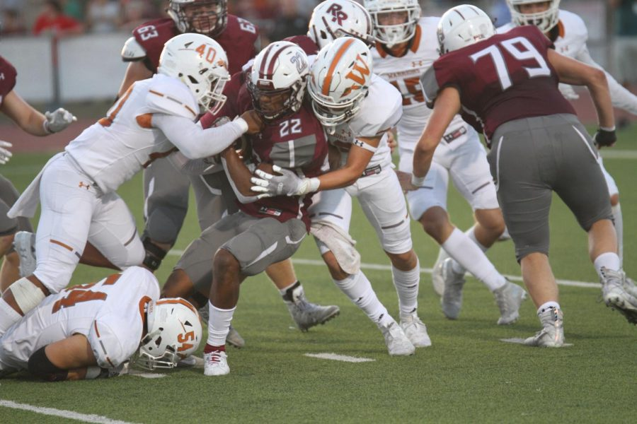 Despite the Round Rock running back's efforts to stay on his feet, Drew Goodall '21 brings him down while Jaleel Davis '20 tries to strip the ball out. The two brought down the running back for a short gain on the play.