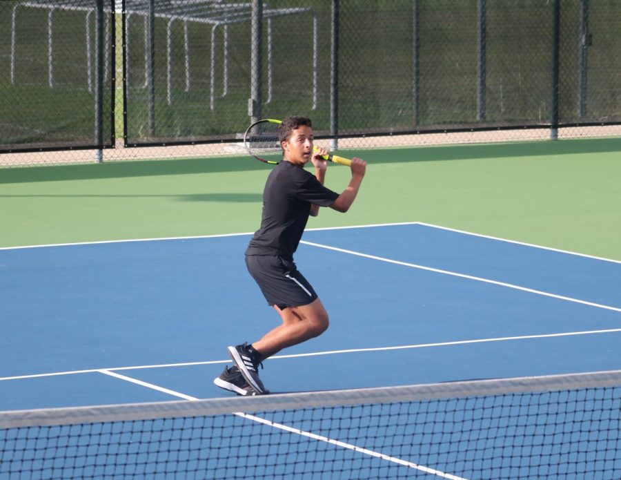 Driving up towards the net, Zeyad Elchouemi '22 executes a clean backhand volley to his opponent. Elchouemi would go on to win his match 8-1.