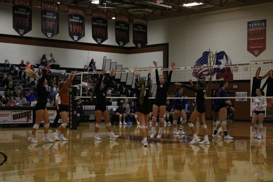 The Lady Warriors celebrate after gaining a point executing a great play. The first home game of this season this game was won in just three sets. Its a really big win when you can win in 3 out of 4 or 5 sets, Assistant coach Amber Hall said.