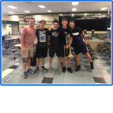 Head band director, Mr Thomas Turpin, poses with Lyle Moss '20, John Kangos '21, Jason Sato '21, and Kyle Le '22 after the audition. Mr. Turpin judged the trombone audition room where Sato, Moss, and Kangos auditioned in.