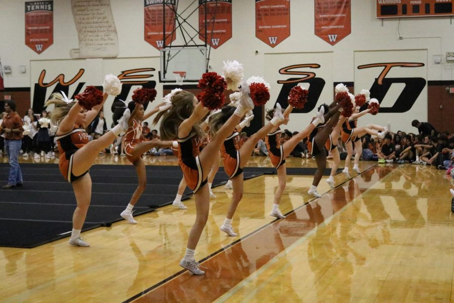 The Westwood cheer leaders were performing as people came in. This along with the band performing their songs gave people a true Warrior welcome.