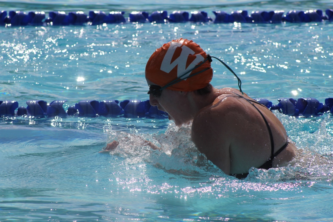 Molly+Sparrow+%2721+swims+the+100-meter+breaststroke.+Sparrow+ended+up+getting+second+in+her+heat%2C+but+still+managed+to+earn+points+for+the+Orange+team.+