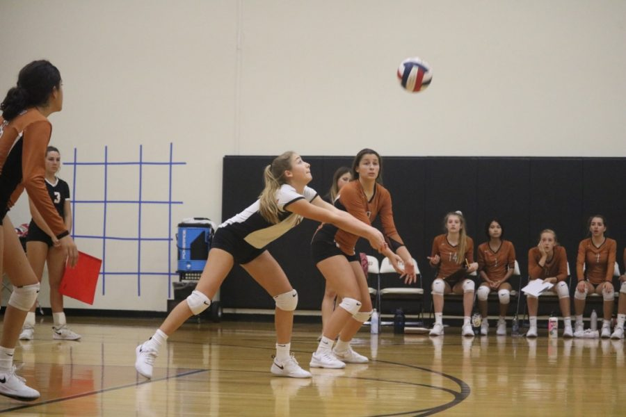 Tanisha Balaggan '23 bumps the ball after it was served by the Raiders. Balaggan was positioned as a middle back hitter.