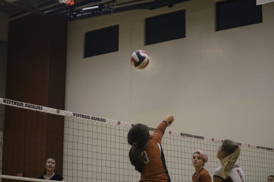Ella Wood '23 bumps the ball over the net. Wood saved the ball from hitting the ground, giving them a point.