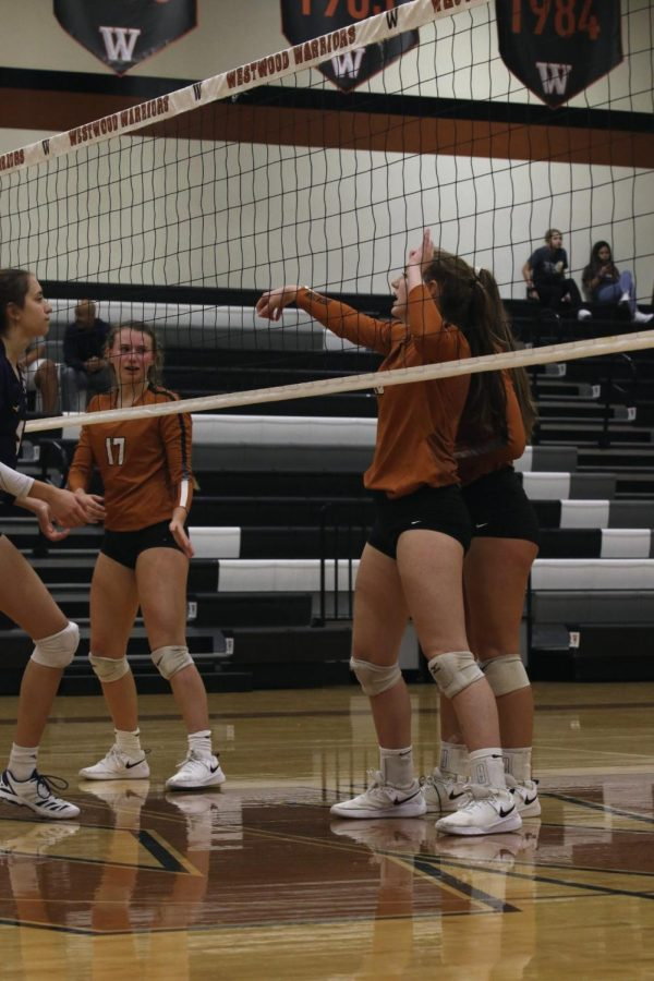 McKayla Ross 22 and Kenzie Beckham 21 communicate before the next play.