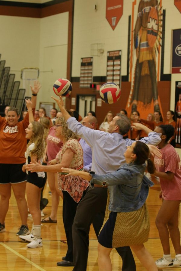 Westwood faculty lines up and attempt to serve the ball over the net.