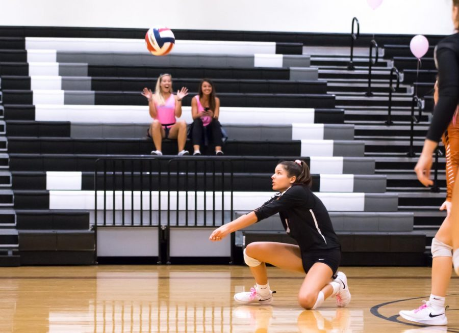 Returning the Mavericks' serve, Alex Kriz '23 bumps the ball. Despite the close score at the time, the Lady Warriors pulled ahead and won the first set 25-23.