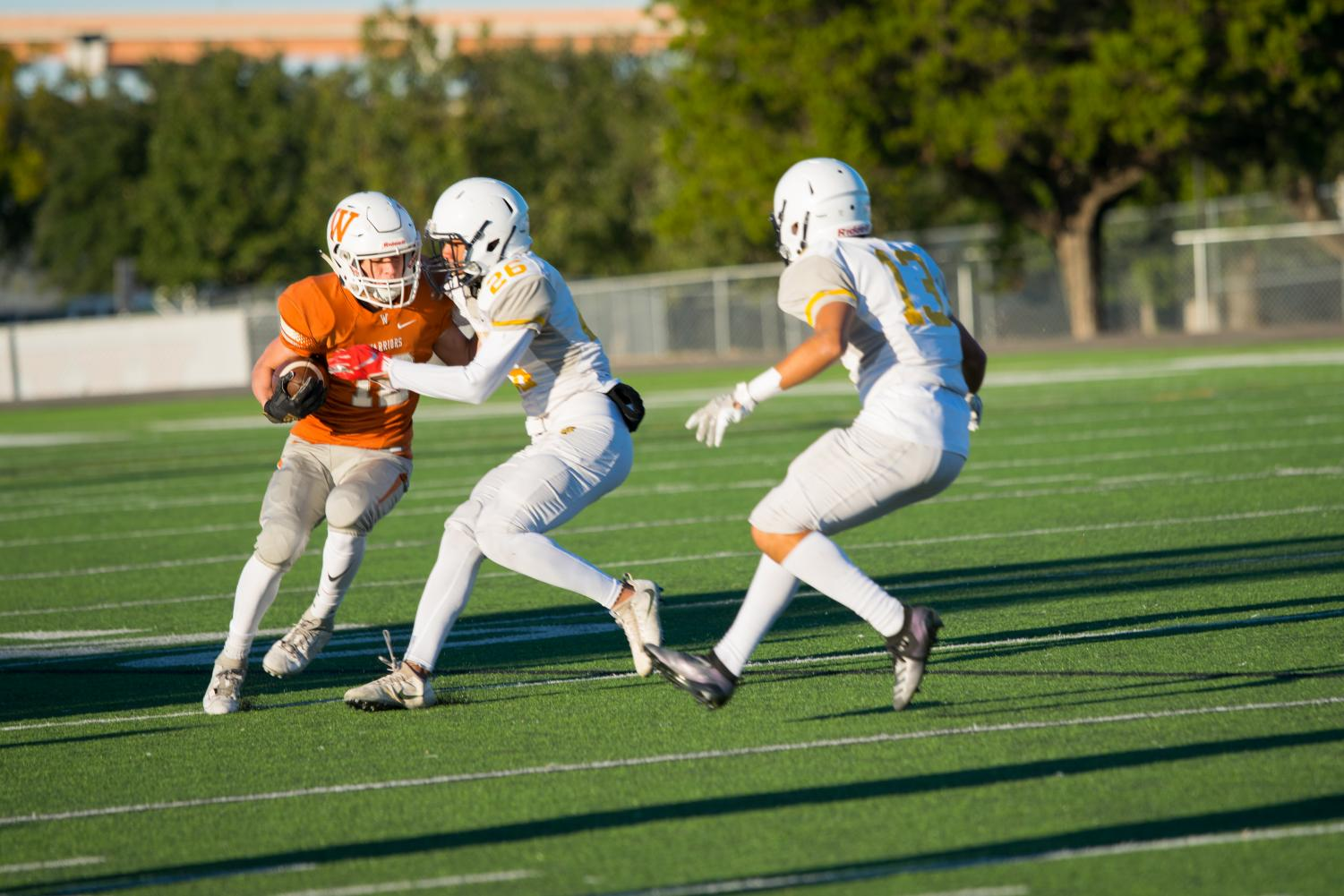 GALLERY%3A+JV+Orange+Football+Drops+Shootout+to+Stony+Point+38-28