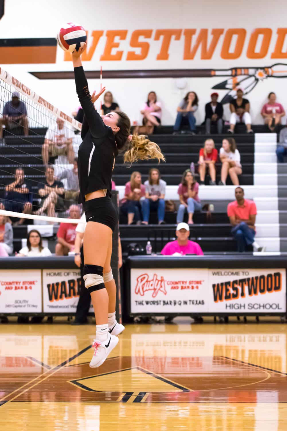 Jumping+in+the+air%2C+Phia+Parent+%2722+pushes+the+ball+over+the+net.+The+Lady+Warriors+took+the+lead+early+on+during+the+second+set.