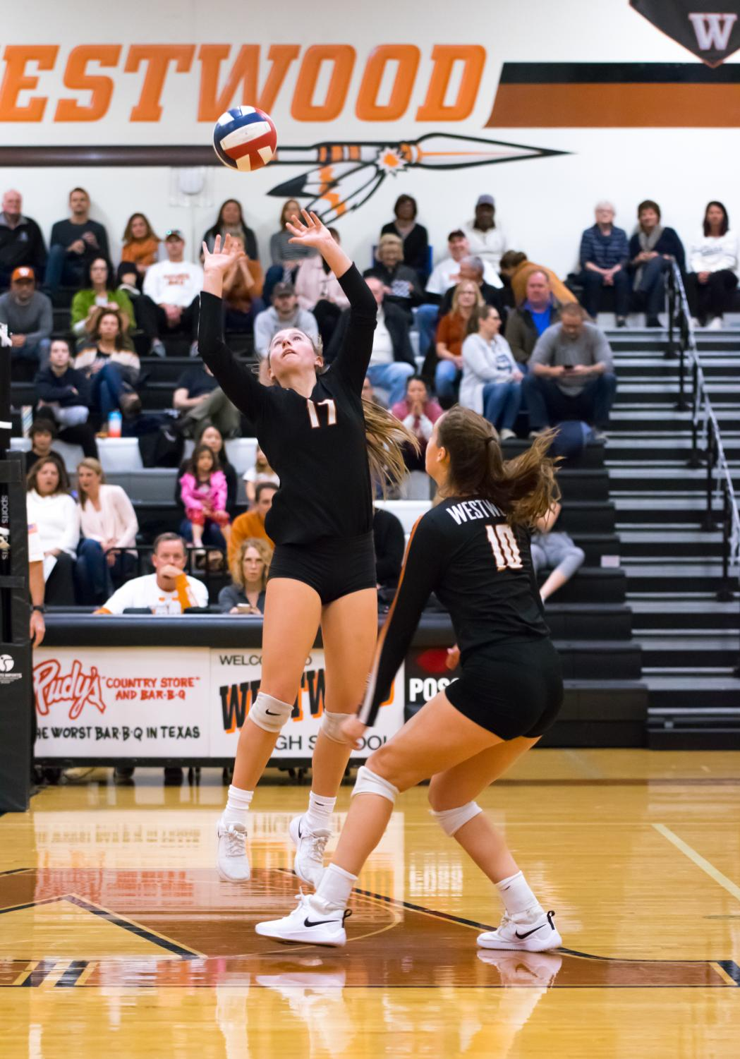 Kenzie+Beckham+%2721+sets+the+ball+for+Audrey+Quesnel+%2720.+Winning+the+point%2C+the+Lady+Warriors+keep+their+early+on+lead+during+the+second+set.