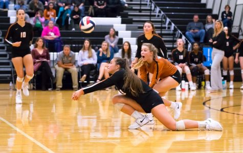 Returning the Lion's serve, Abby Gregorczyk '21 gets down low to bump the ball. Despite the winning point, the Lady Warriors could not pull ahead in the set.