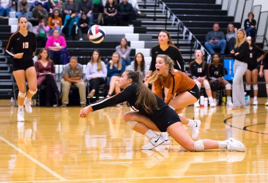 In a match against Leander last season, Abby Gregorczyk '21 gets down low to return the Lions' serve. The varsity volleyball team will begin district play on Friday, Sept. 25 at home against McNeil.