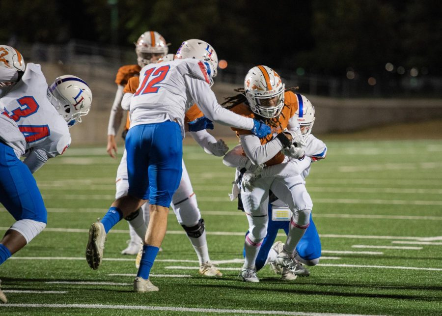 Nate Anderson '21 pushes through Leander defense. Anderson has player on the varsity team for 2 years, during his time on the team Anderson has carried the ball a total of 1773 yards.