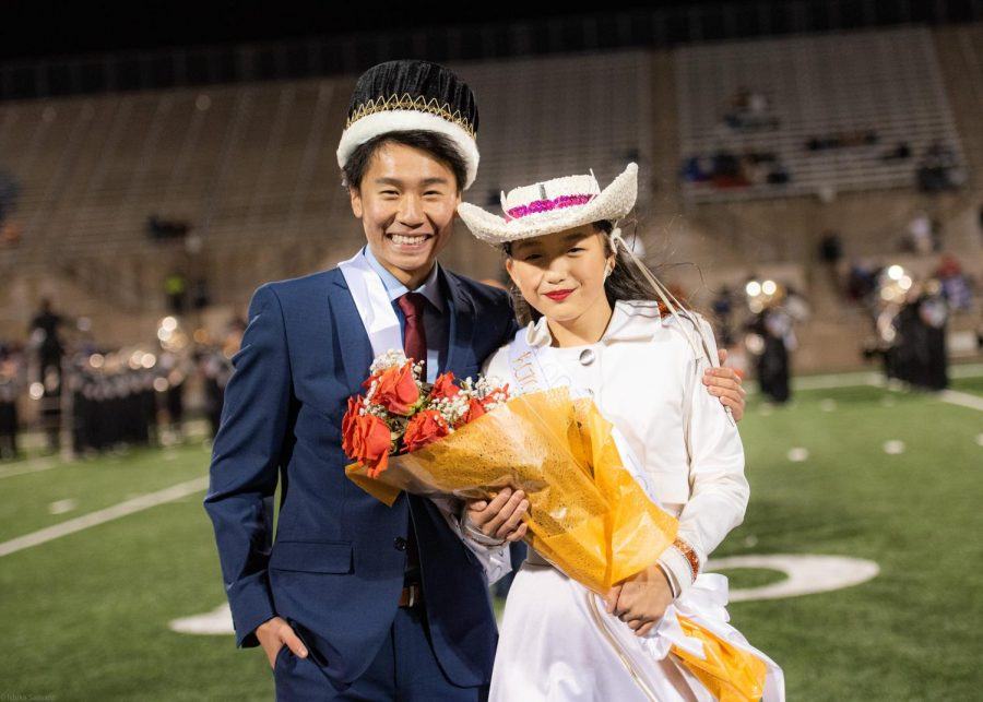 Homecoming King and Queen, Brandon Qin '20 and Ashley Zhang '20 pose for the photographers after winning the title. Homecoming started in colleges celebrating the first game of the season in which alumni could return for their alma maters.