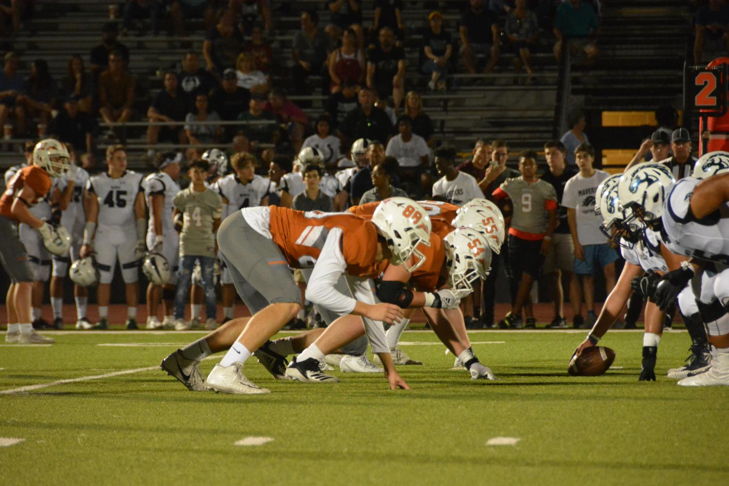 Defensive+linemen+Josef+Borkowski+%2721%2C+Dylan+Vorpahl+%2720%2C+and+Jackson+Metzger+%2721+get+in+their+stances+before+the+Mavericks+execute+their+play.+Due+to+the+defensive+line%27s+pressure%2C+the+defense+was+able+to+prevent+the+Mavericks+from+getting+a+first+down+on+this+play.